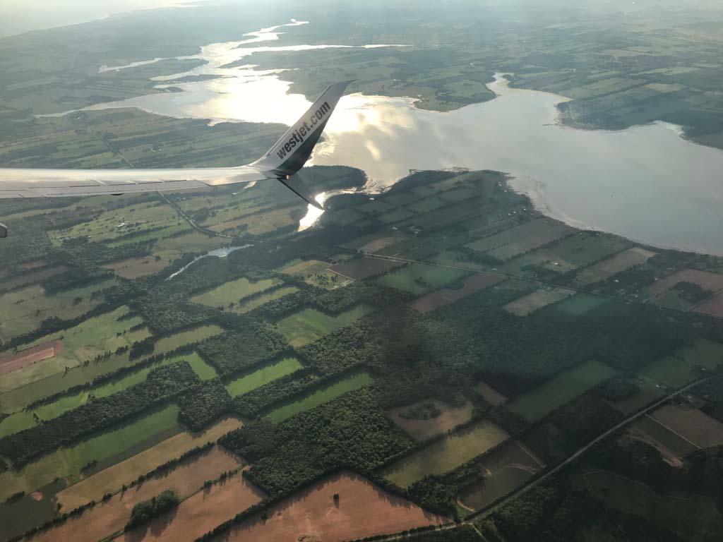 westjet-plane-flying-over-pei