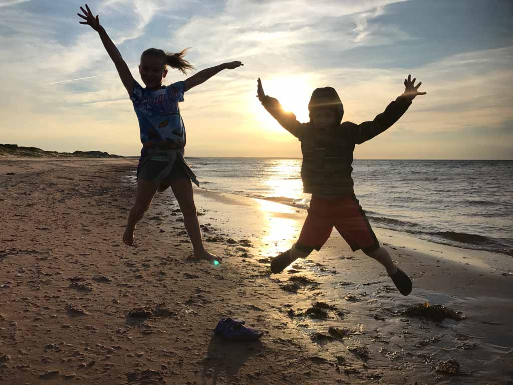 Kids jumping on Brackley Beach in PEI