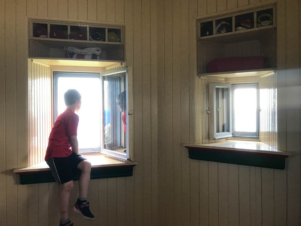 Boy looking out window of castle at Signal Hill National Historic Site