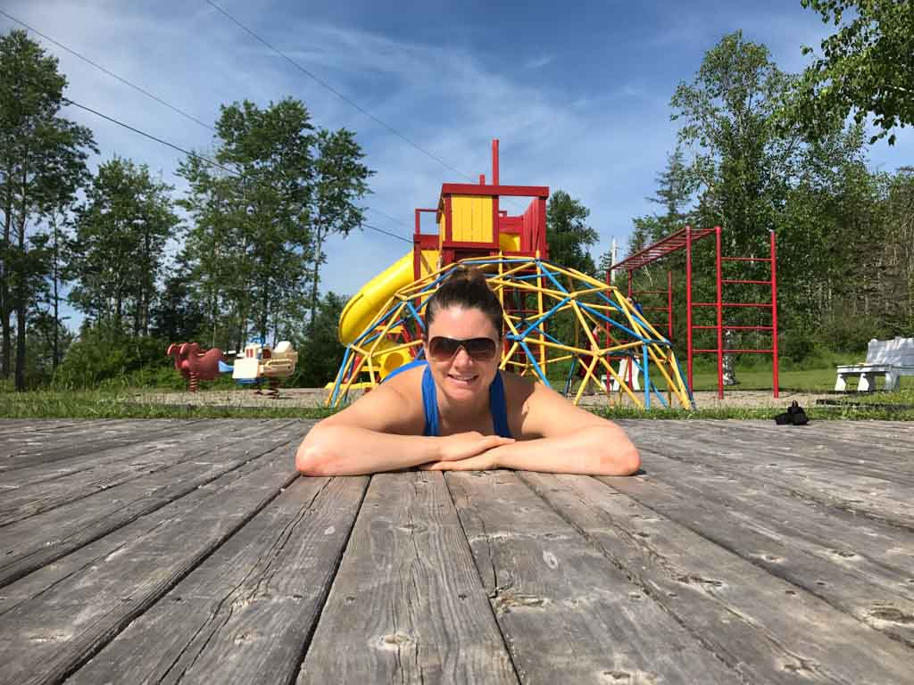 woman-lying-in-front-of-playground