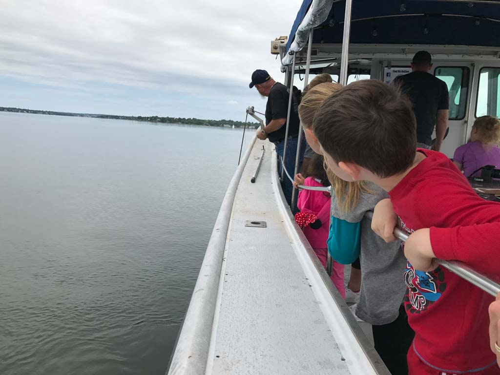 kids-watching-lobster-traps-over-side-of-boat