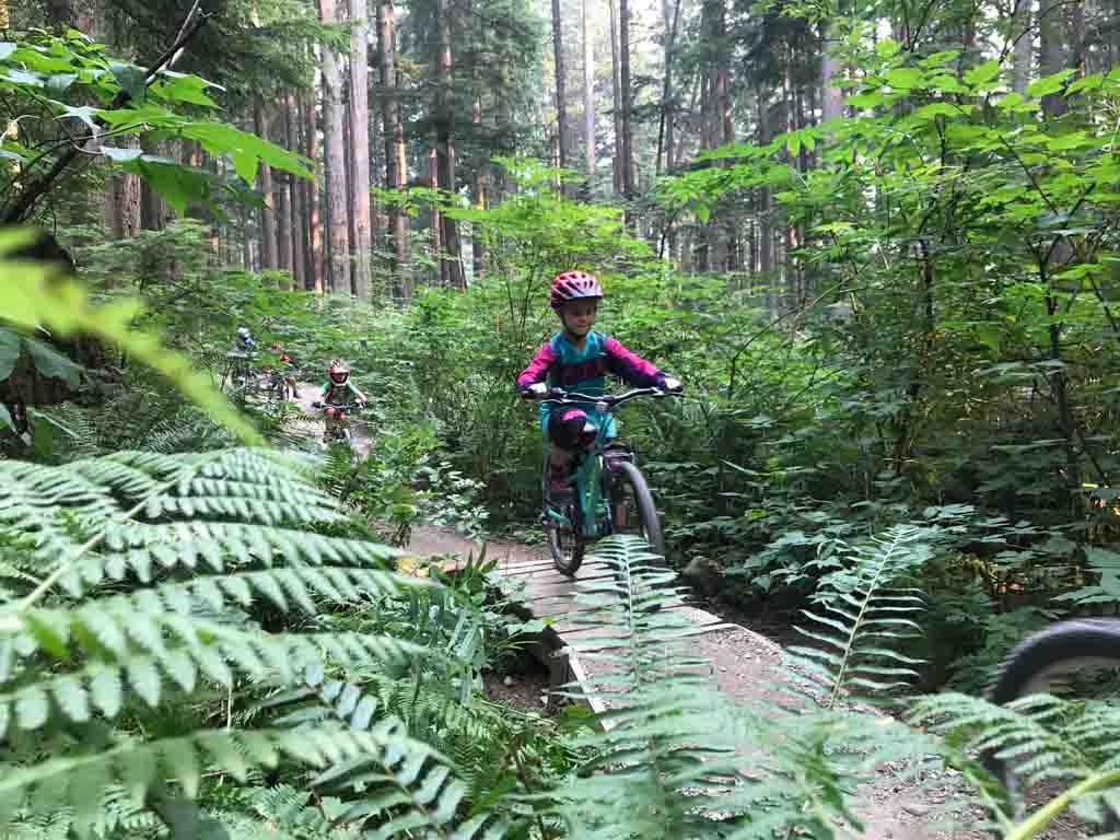 child-going-down-mountain-bike-trail