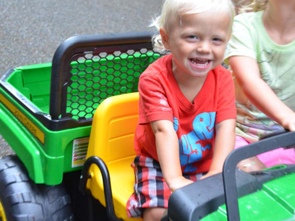 Mini John Deere tractor for best outdoor gifts for kids