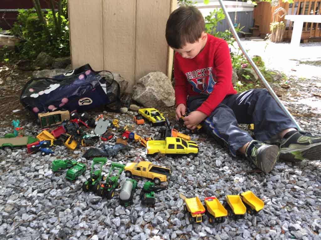 Various toy trucks and cars for the best outdoor gifts for kids
