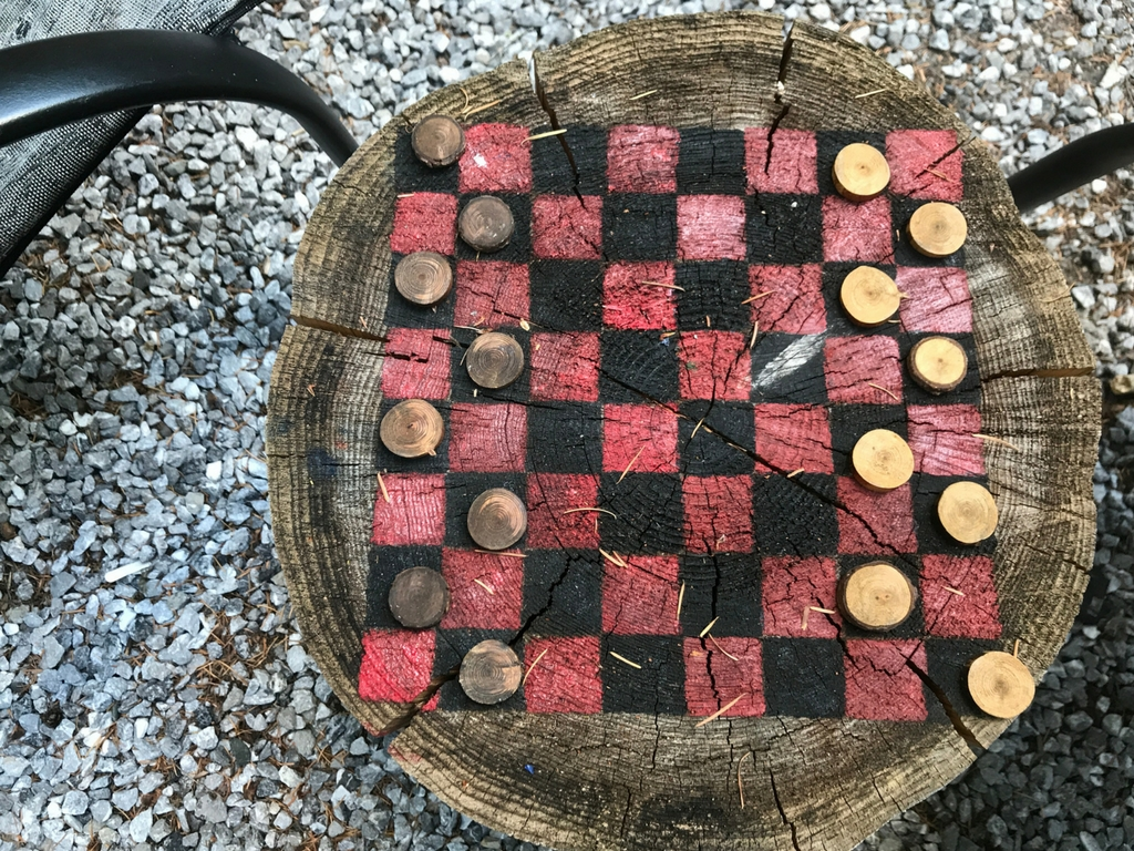 Checkerboard made from a log for the best outdoor gifts for kids