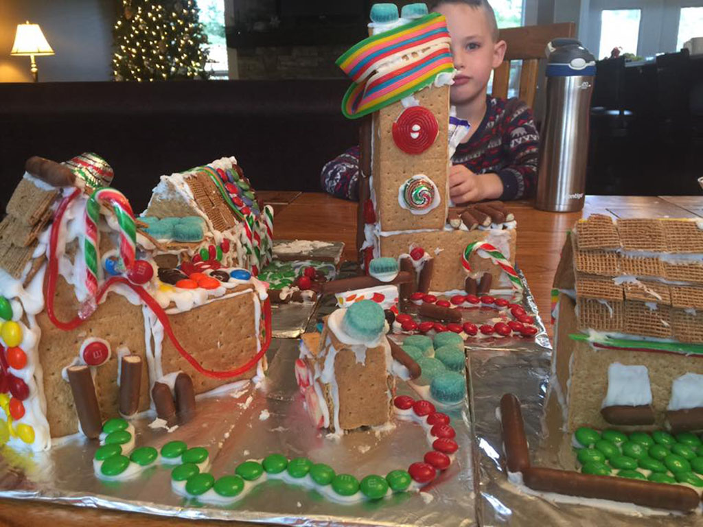 Boy decorating gingerbread houses for adventure advent calendar