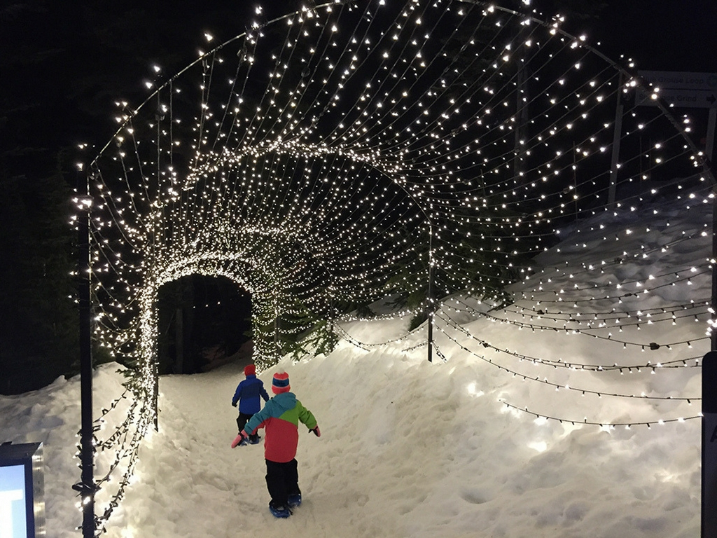 kids-walking-under-christmas-lights-on-grouse-mountain