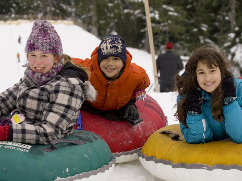 Kids tubing at Mount Seymour for Christmas activities in Vancouver