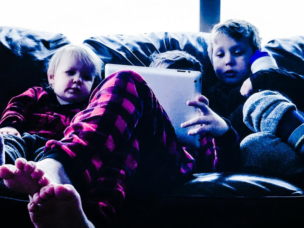 Kids watching iPad on their Big White family ski trip