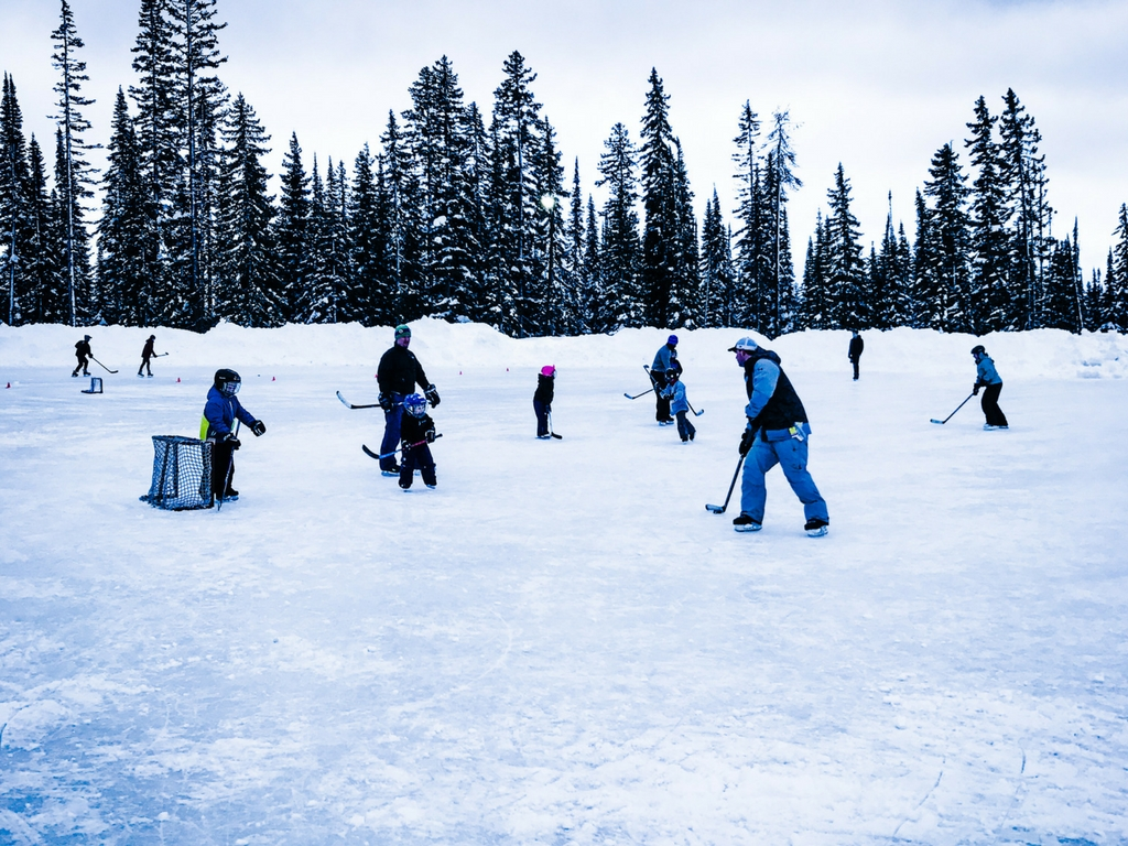 Skating on outdoor rink on a Big White family ski trip