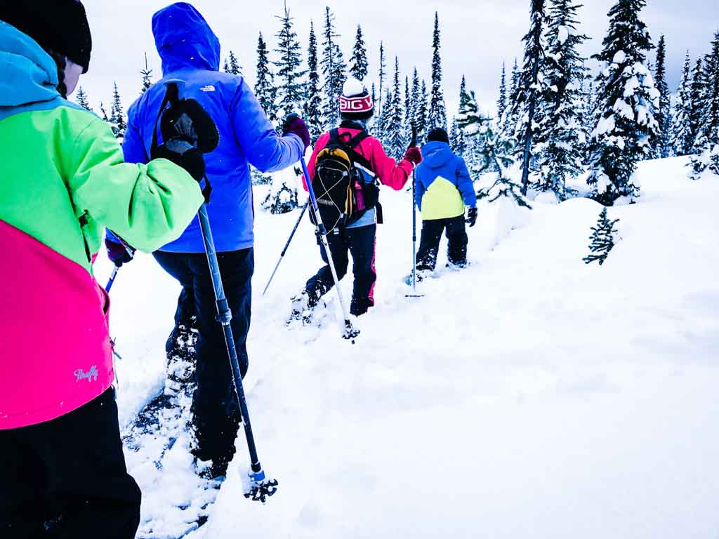 family-on-big-white-snowshoe-tour