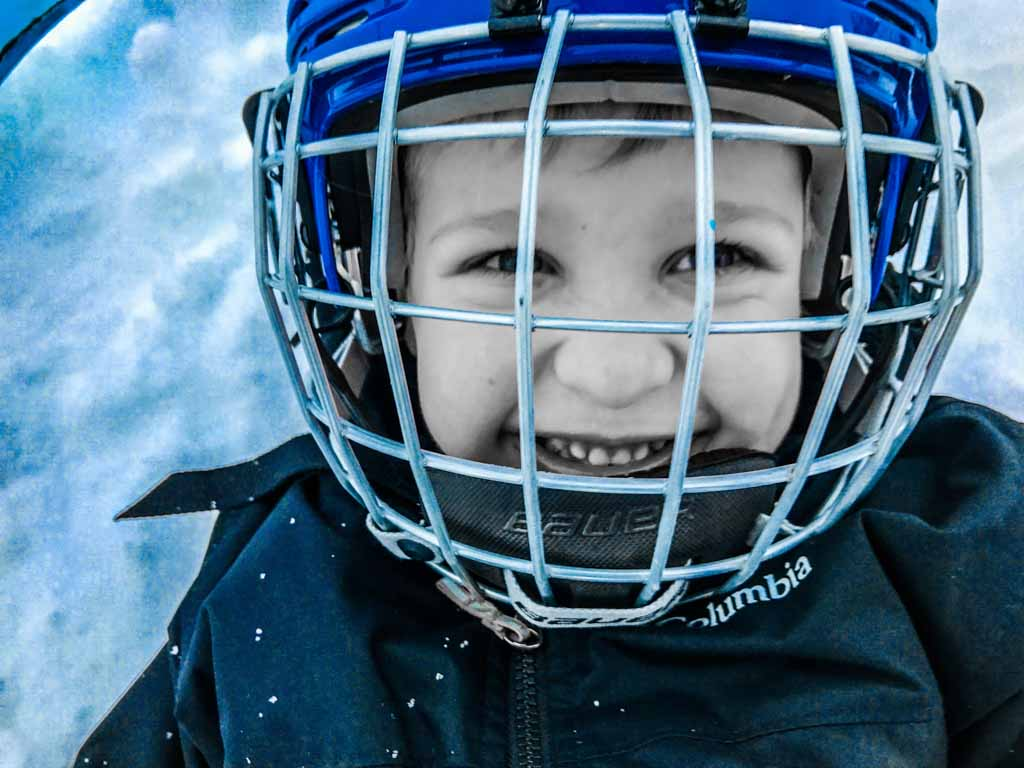 little-boy-wearing-hockey-helmet