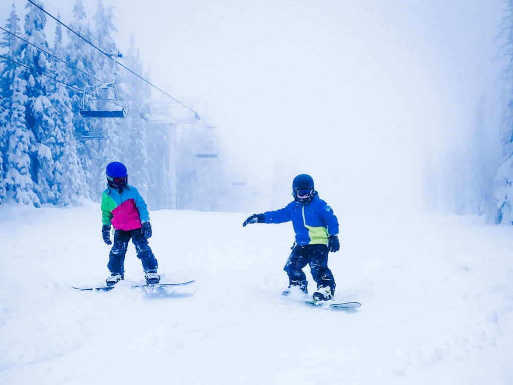 Kids snowboarding on Big White family ski vacation