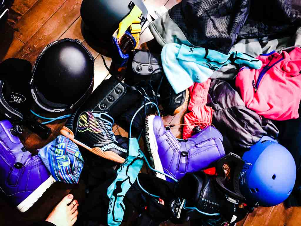Ski and snowboard gear on a Big White family ski trip