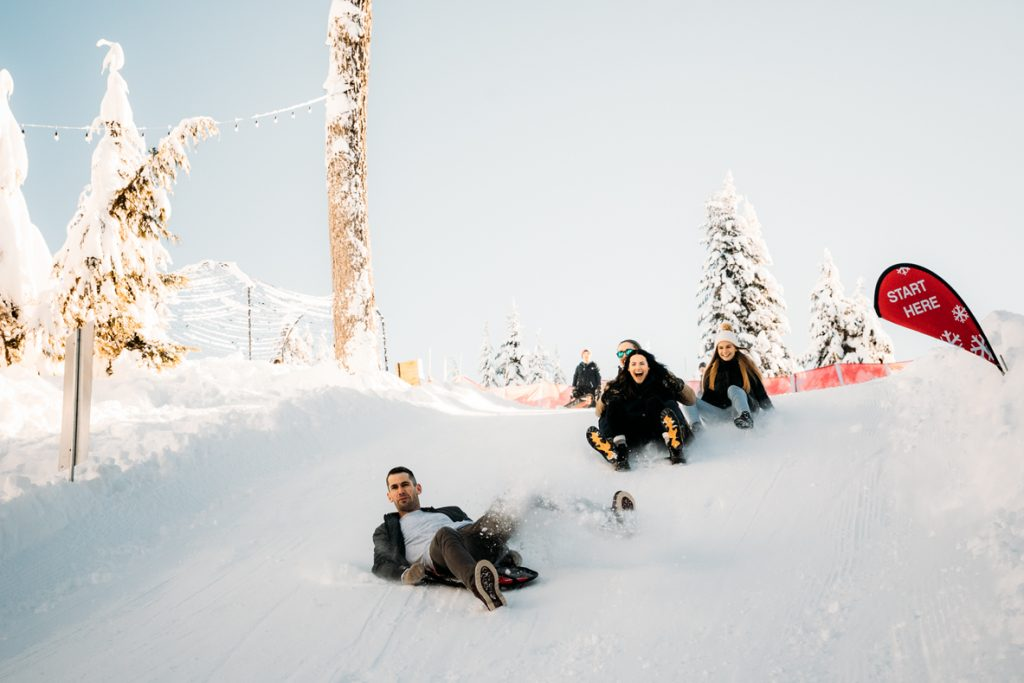 People sledding on Grouse Mountain for Vancouver day trips for families