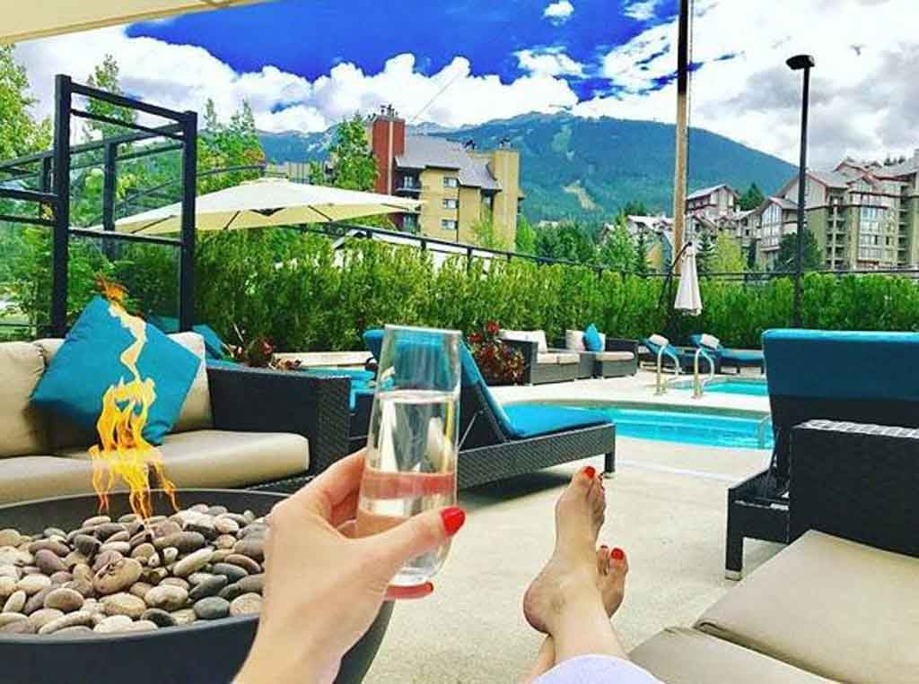 Relaxing by the pool at Aava Hotel for family reunion sites in BC