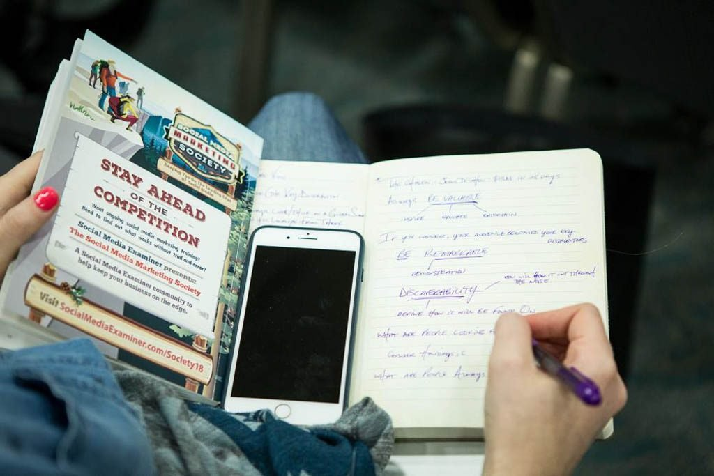 woman-taking-notes-at-conference