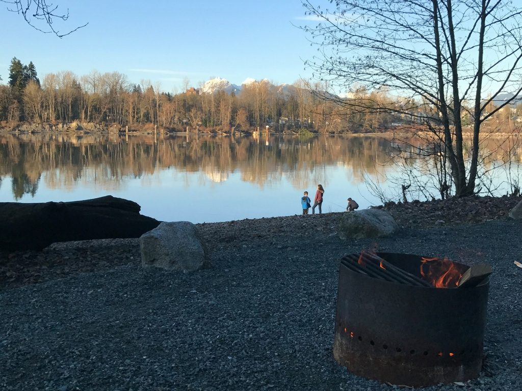 Kids on a beach by campfire for Free Spring Break Activities in Vancouver