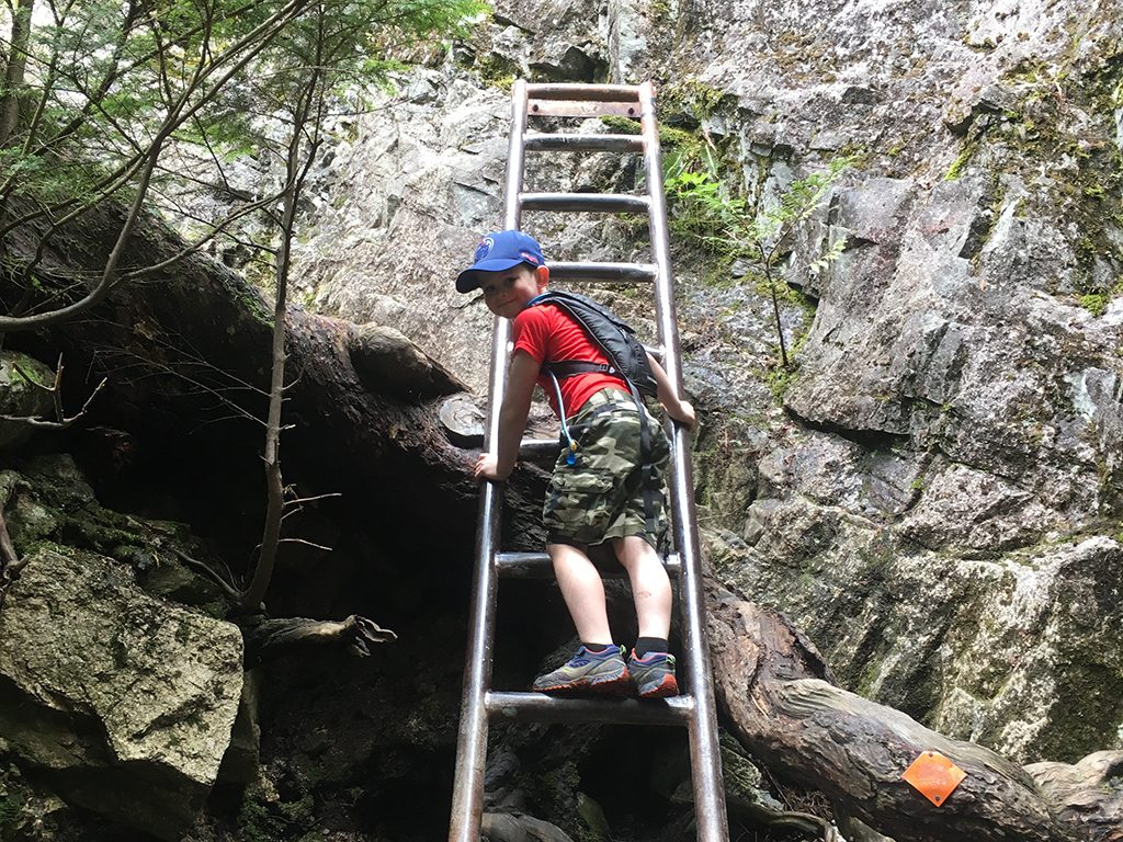 boy-climbing-ladder-on-the-chief-hike