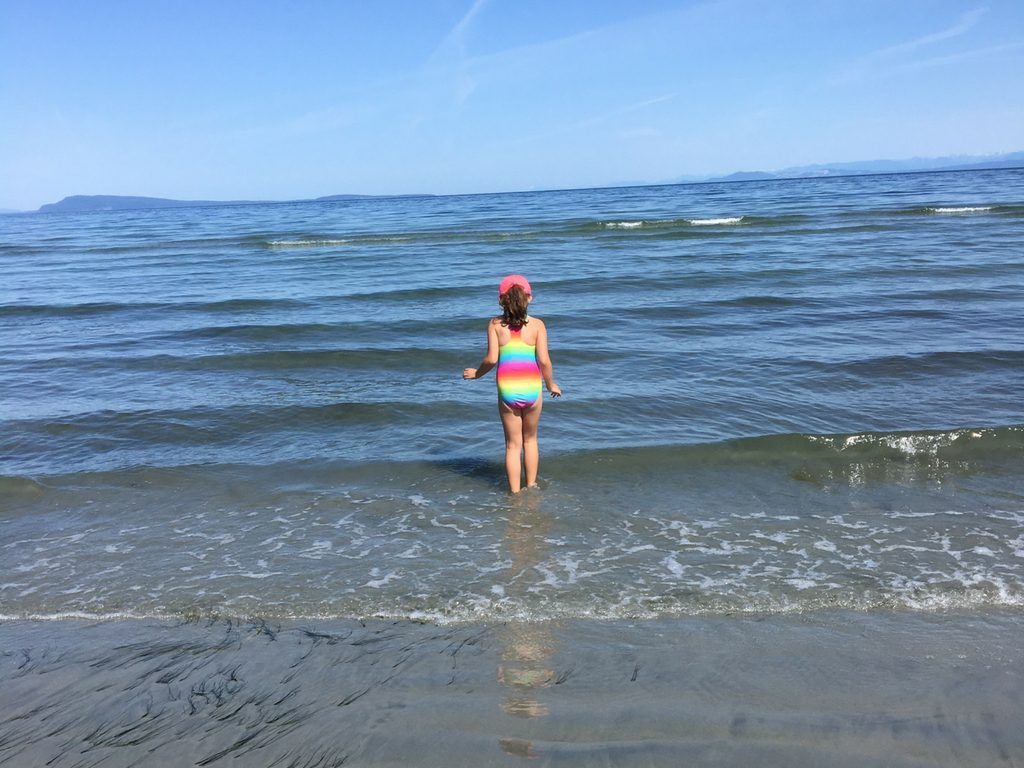 girl-playing-on-qualicum-beach