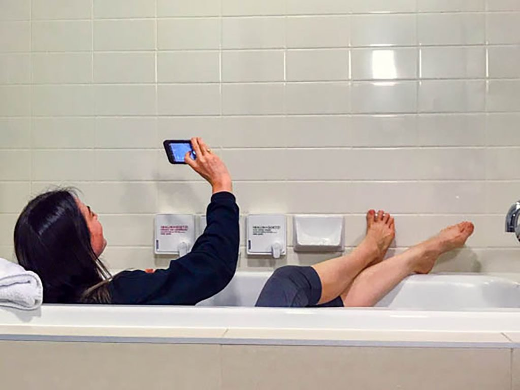 Jami Savage taking a selfie in the tub on her Whistler Girls Weekend