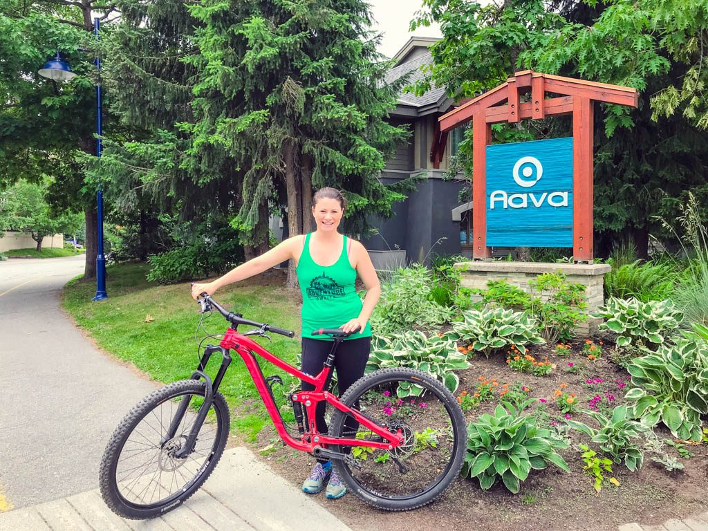 Jami Savage with mountain bike from Aava hotel on her Whistler Girls Weekend