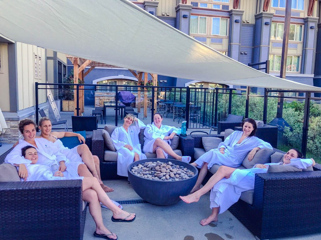 Group of women relaxing around the pool on a Whistler Girls Weekend