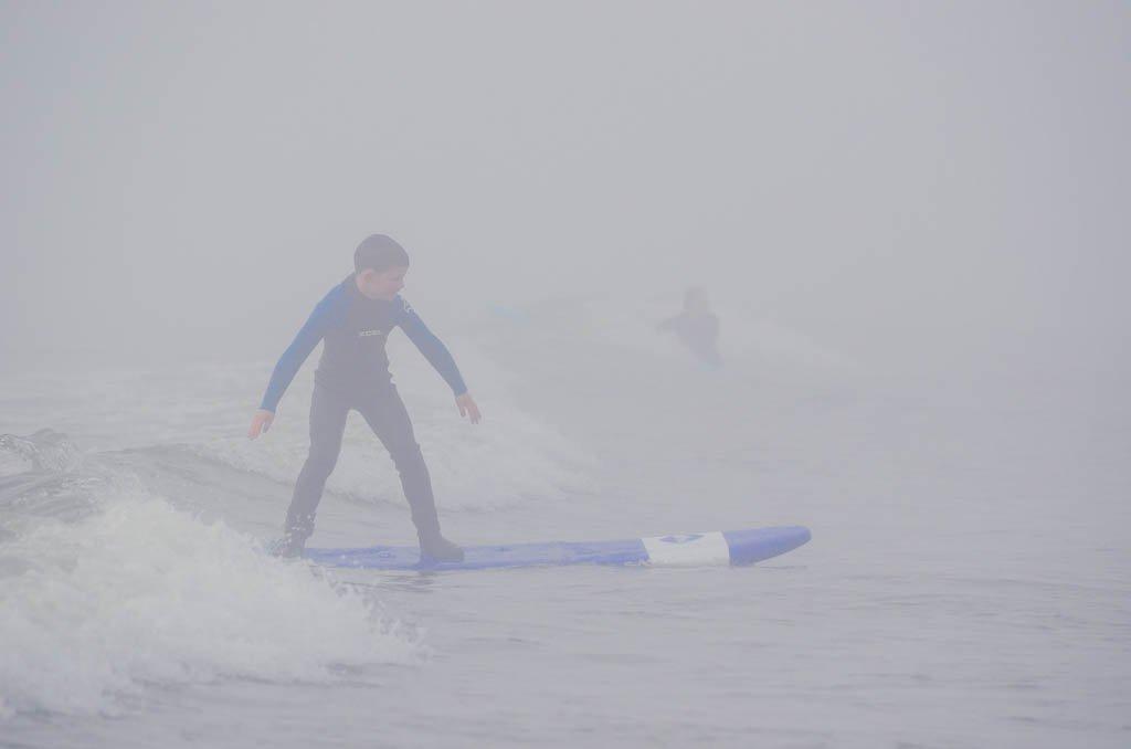 Boy surfing in Tofino
