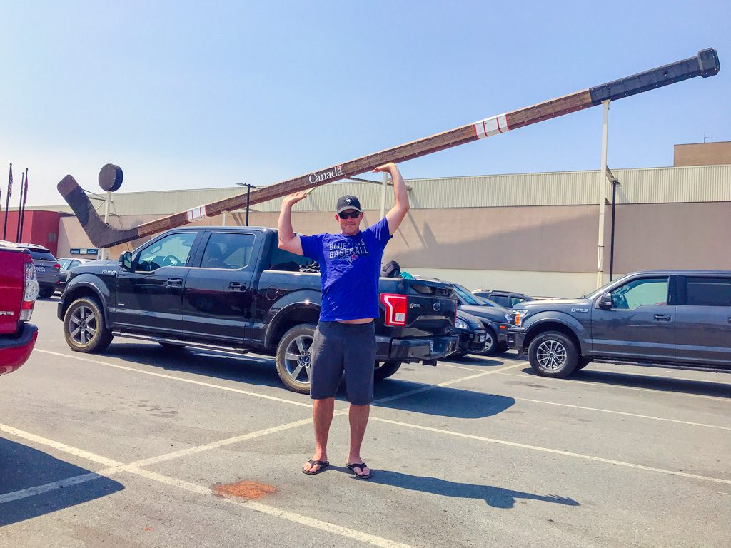 man-holding-giant-hockey-stick-in-cowichan