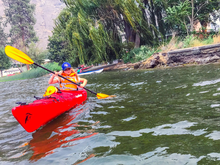girl kayaking with hoodoo adventures penticton