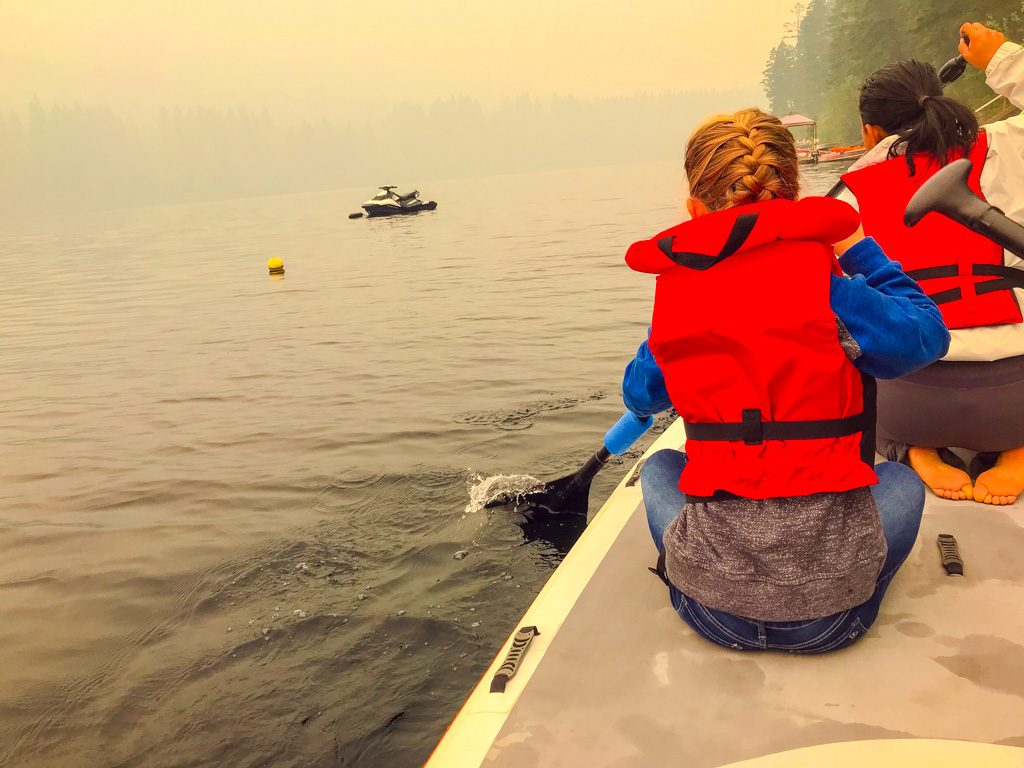 Children on paddle board from Heffley Lake Paddle board rentals
