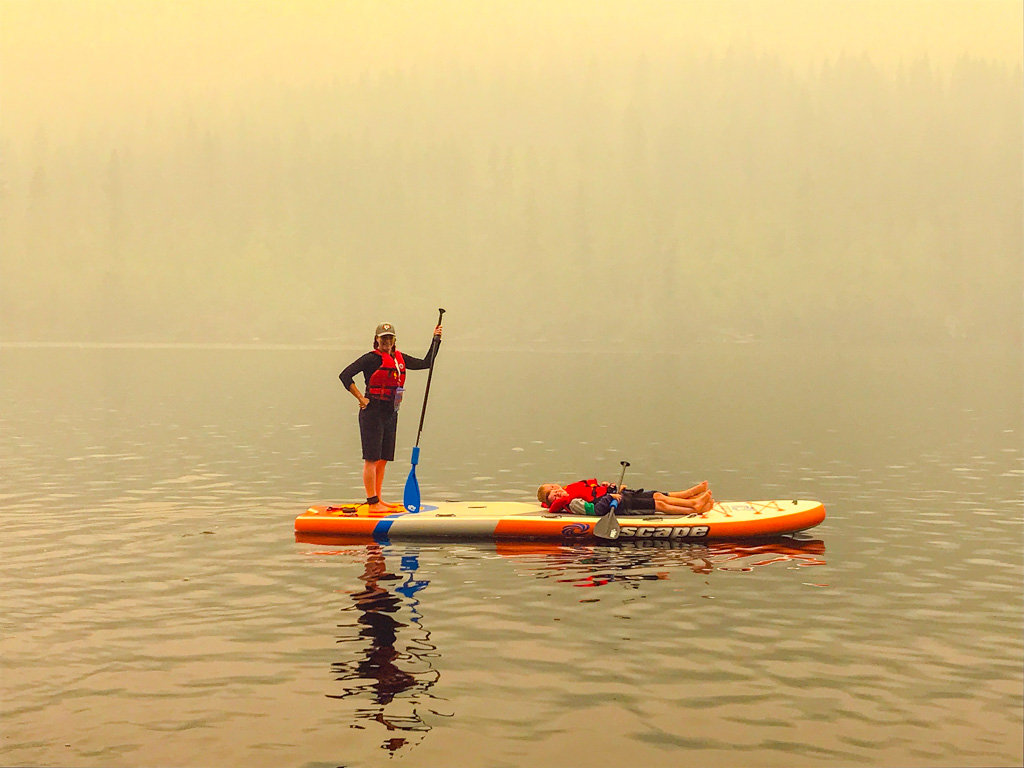 Jami Savage on a paddle board at Heffley Lake paddle board rentals