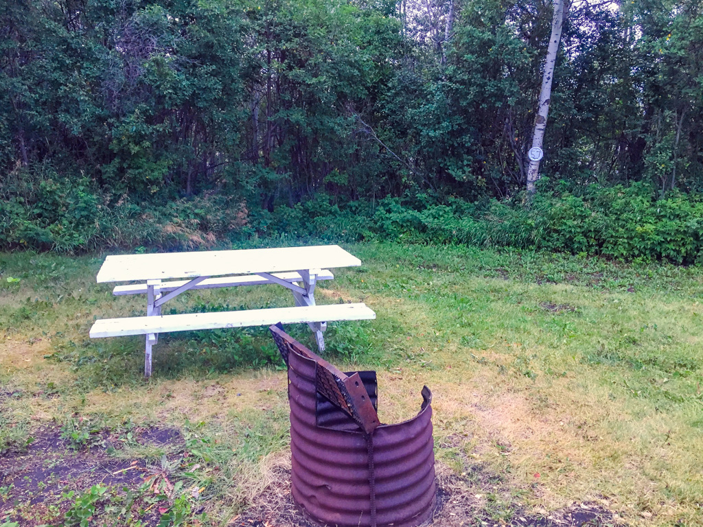 Spruce Bay picnic table and fire pit from camping in the Canadian Badlands