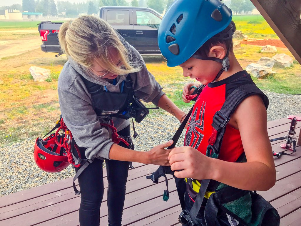 boy-getting-on-zip-lining-gear