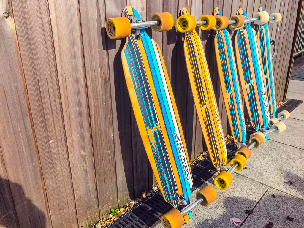 longboards-leaning-against-fence