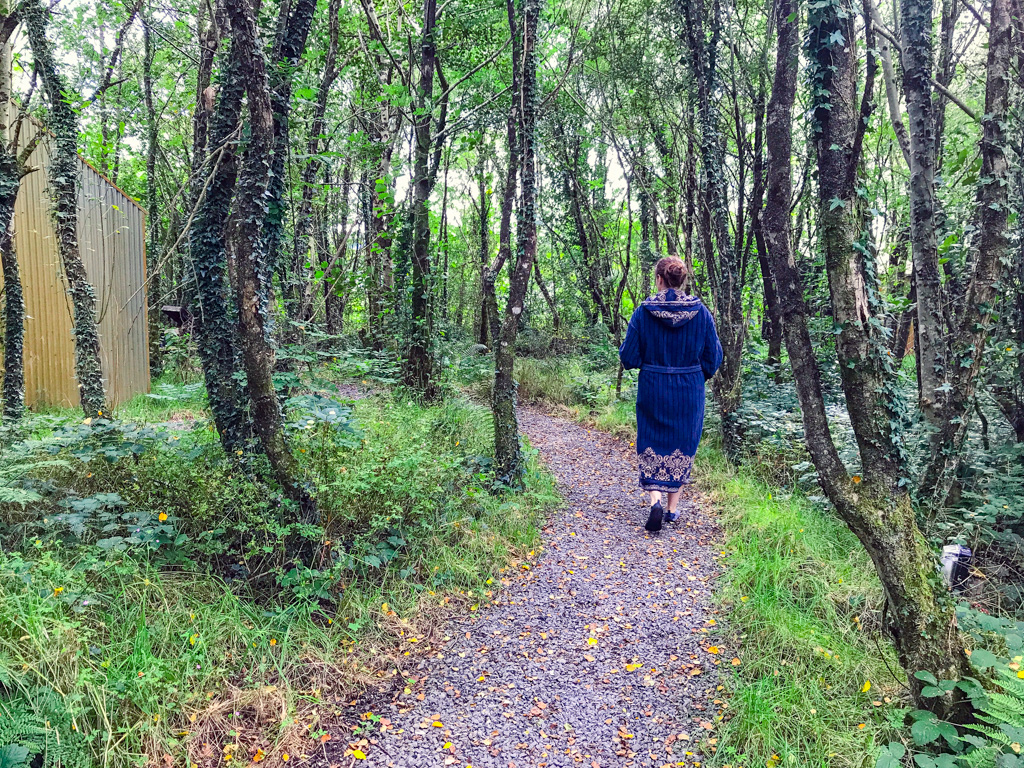 woman-walking-through-forest-at-finn-lough-spa