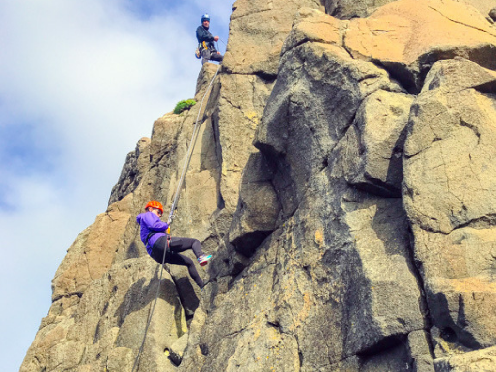 woman repelling during Rock Climbing Northern Ireland