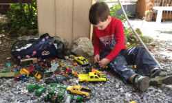 kid-playing-outside-with-cars