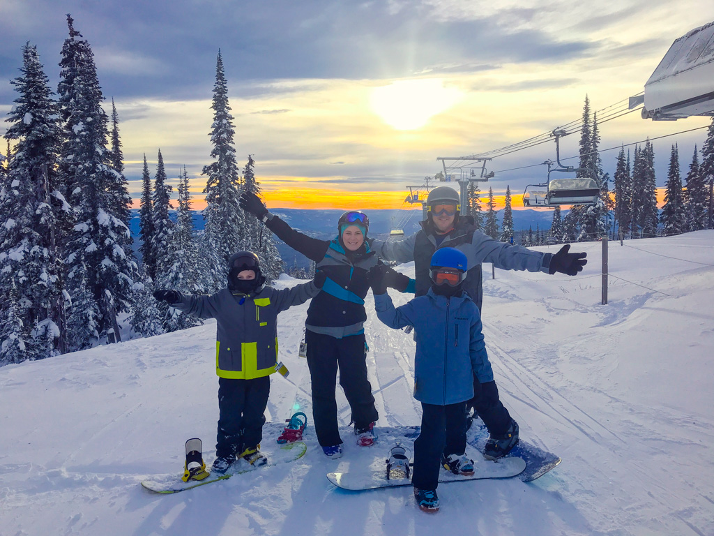 Jami Savage and family on top of Sunpeaks Mountain