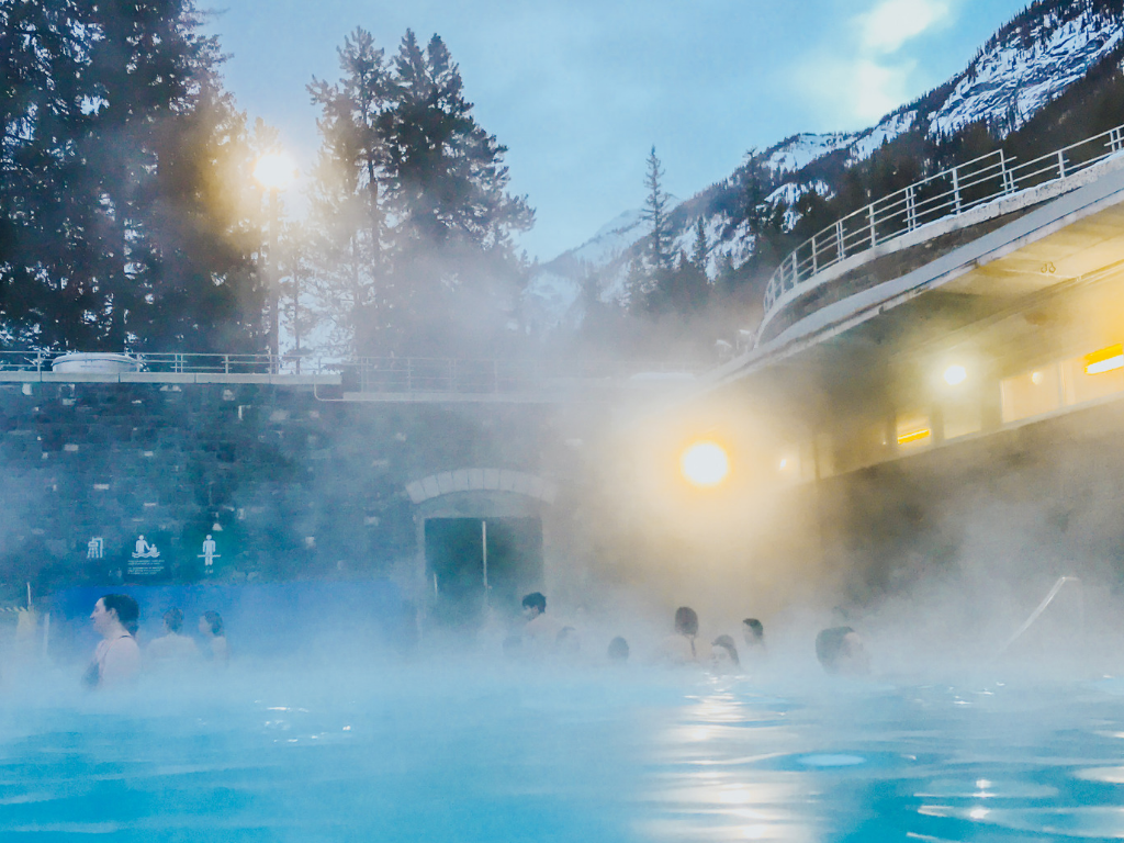 People soaking in banff hot springs