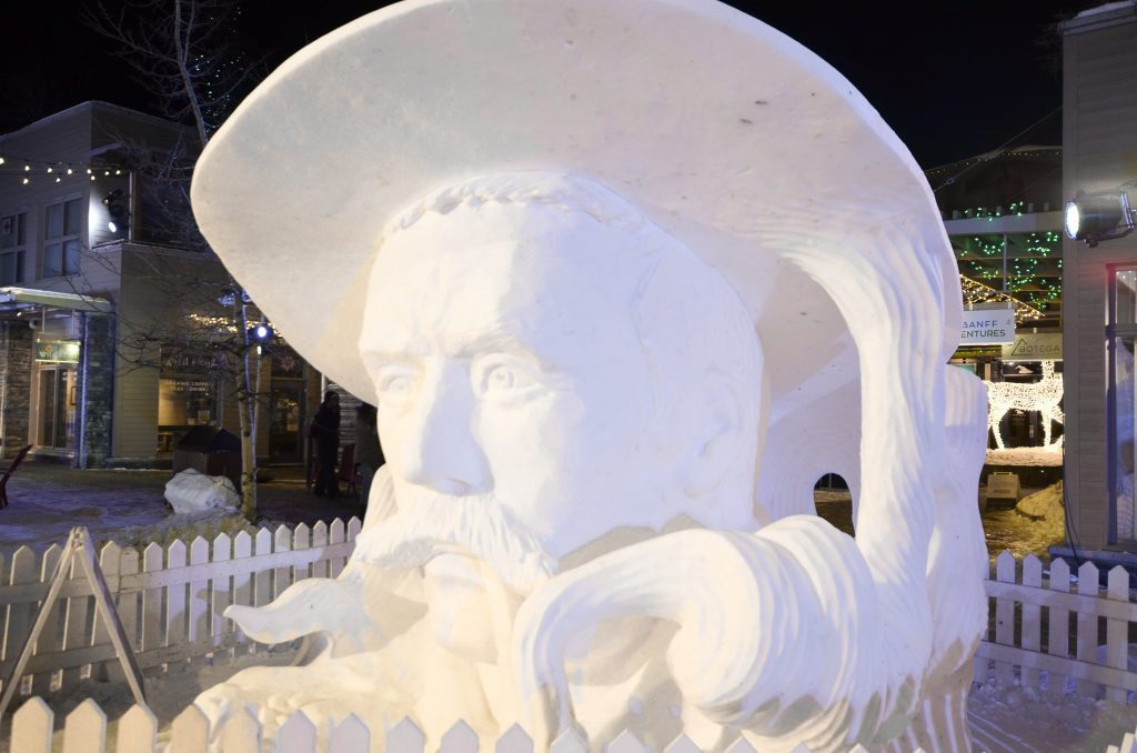 Snow sculpture of a man's head at Banff Snowdays Festival