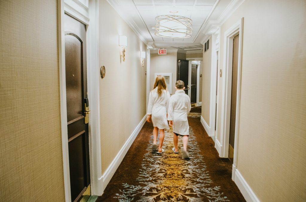kids-walking-down-hallway-in-robes