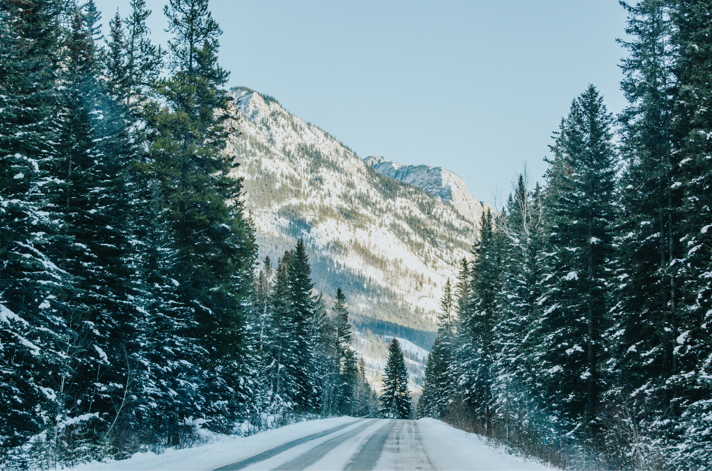 Old snow covered highway seen during Banff photography tours