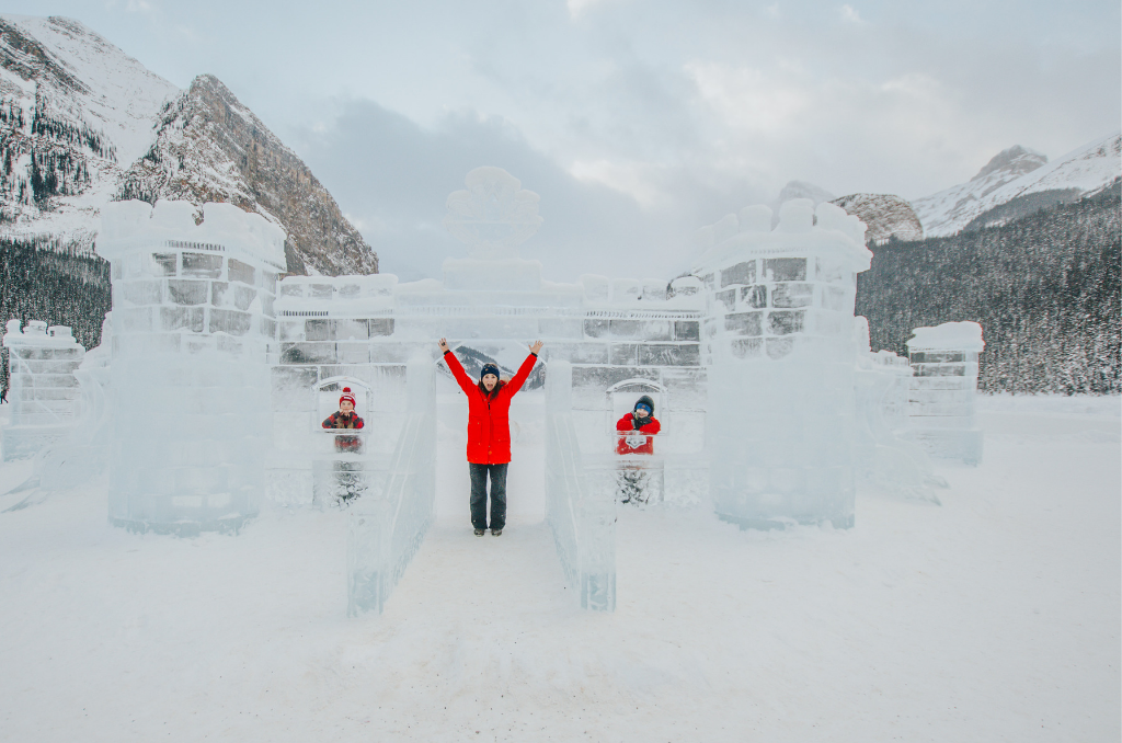 Jami Savage inside ice castle at Lake Louise ice festival for the classic Canadian Winter