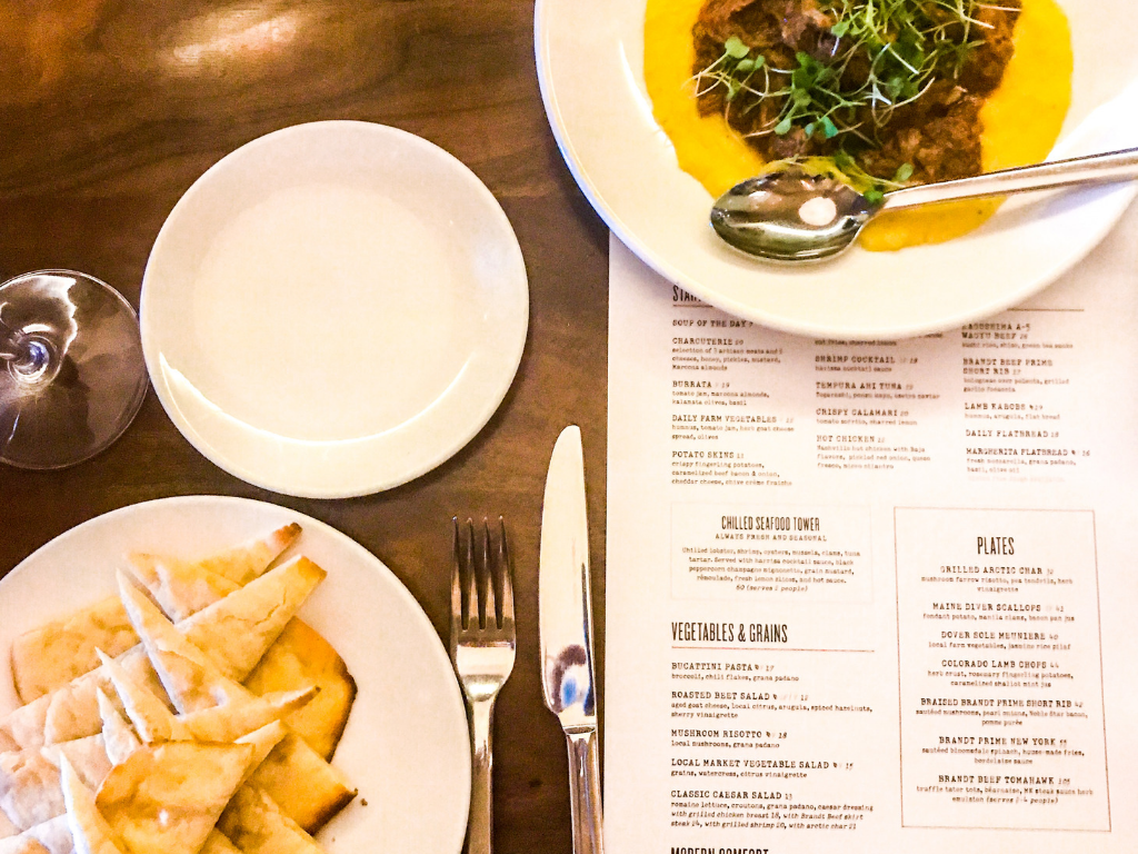 Food and menu on the table at marina kitchen restaurant