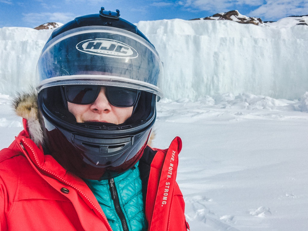 woman-in-gear-for-snowmobiling-through-the-arctic