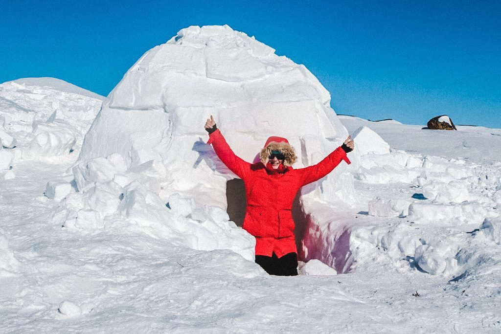 woman-in-igloo-while-snowmobiling-through-the-arctic