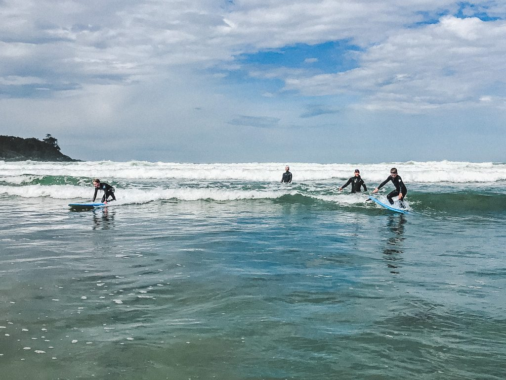 boy-and-girl-surfing-in-tofino