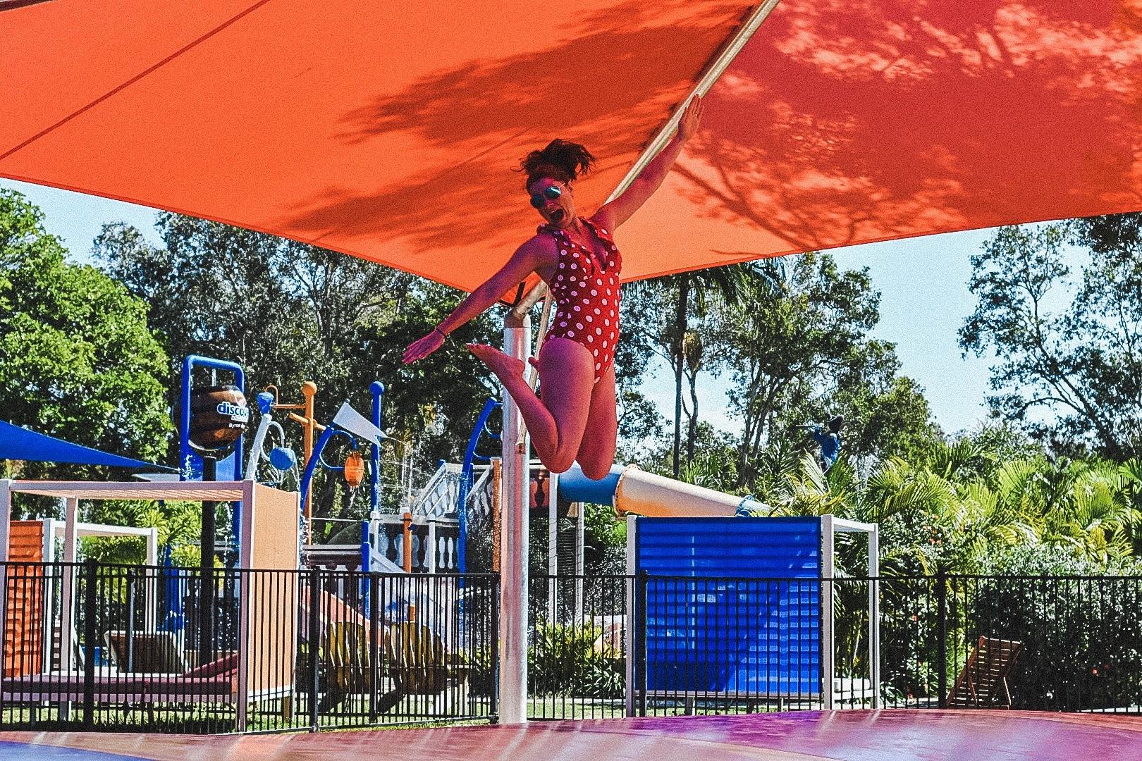 Jami-jumping-at-discovery-parks-byron-bay
