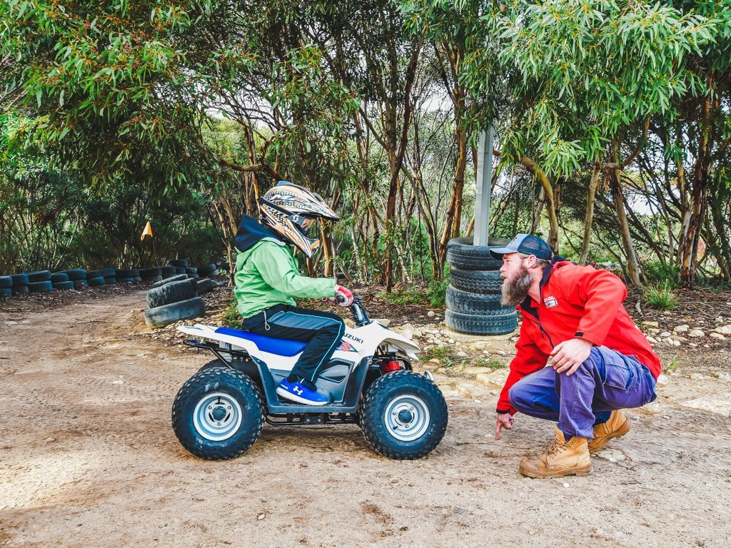 man teaching child to ride a quad at Kangaroo Island Outdoor Action